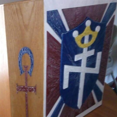 Symbol of Divine Truth Ministries, left, and Aryan Nations, right