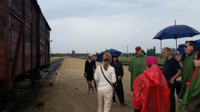 ADL delegation at Auschwitz-Birkenau in front of a cattle car used for deportations.