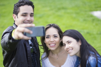 Family taking picture with mobile phone (iStock_000041774914)