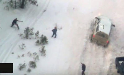 "Helicopter footage of shooting of ""LaVoy"" Finicum (middle) as he seems to reach for a weapon."